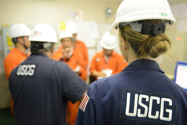 Tim Wilcox and Petty Officer 2nd Class Cindy Washburn, port state control officers at Coast Guard Sector Honolulu Prevention, speak with crew members during an inspection of the engine room aboard the 600-foot Panamanian-flagged bulk freight ship Teizan, at Kalaeloa Barbers Point Harbor, May 19, 2015. Coast Guard crew members conduct inspections to ensure a vessel has a suitable structure, correct documentation, proper working equipment and lifesaving equipment, and adequate accommodations. (U.S. Coast Guard photo by Petty Officer 2nd Class Tara Molle)