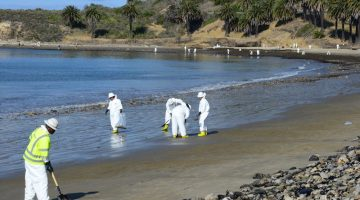 Beach cleanup crew members work to cleanup oil from the beach at Refugio State Beach, Calif., May 22, 2015. The oil spilled into the Pacific Ocean from a broken on-land pipeline impacted the coasts and maritime environment north of Santa Barbara.U.S Coast Guard Photo
