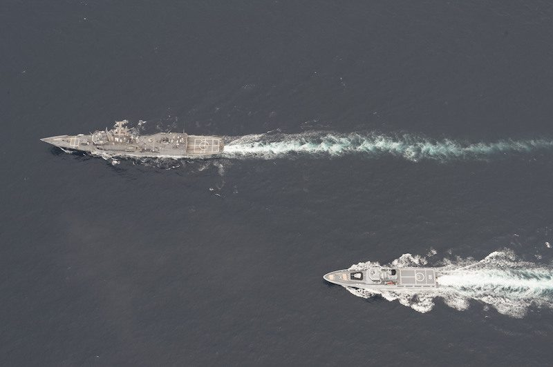 The Oliver Hazard Perry-class guided-missile frigate USS Rodney M. Davis (FFG 60), top, and the Royal Brunei Navy Darussalam-class offshore patrol vessel KDB Darulaman (PV 08) conduct maneuvering exercises while participating in Cooperation Afloat Readiness and Training (CARAT) Brunei 2014.