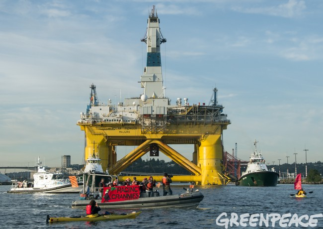 The Raging Grannies activists stand in the way of Shell's Drilling Rig Polar Pioneer as it leaves Seattle's Elliott Bay bound for the Arctic on June 15, 2015. Photo: Greenpeace/Flickr