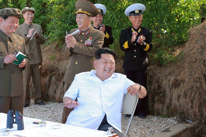 KCNA picture shows North Korean leader Kim Jong Un watching a test-firing drill of anti-ship missiles at sea