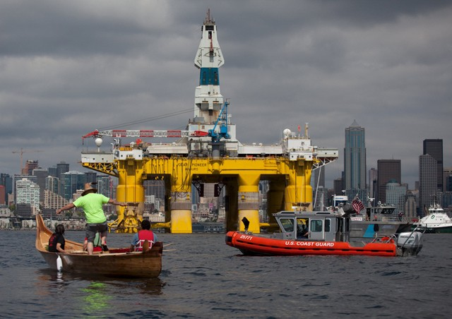 Protester's against the Shell Oil Company's drilling rig Polar Pioneer as it arrives in Seattle, Washington, May 14, 2015. Image (c) REUTERS/Matt Mills McKnight