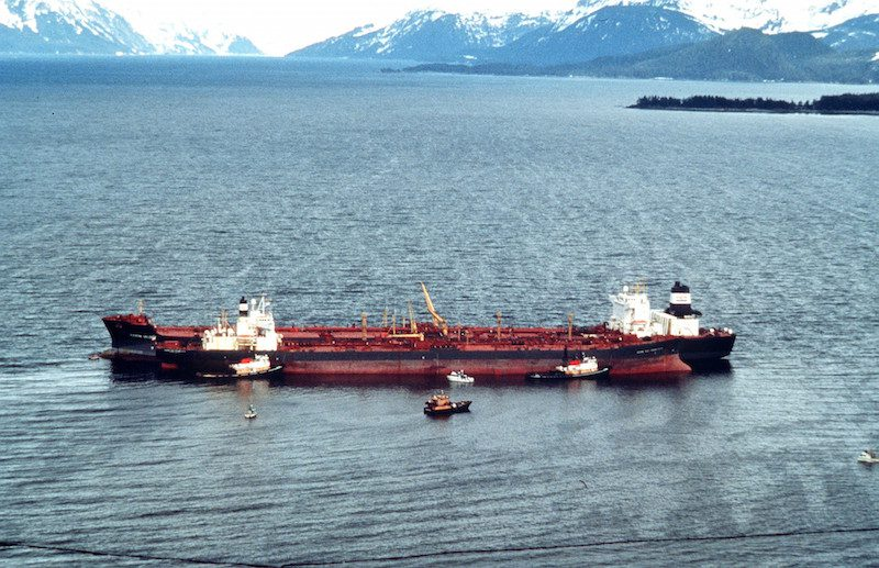 The Exxon Valdez sits in place in Prince Williams Sound after running aground. The Exxon Valdez ran aground on Bligh Reef in Prince William Sound, Alaska, March 23, 1989 spilling 11 million gallons of crude oil, which resulted in the largest oil spill in U.S. history. U.S. Coast Guard Photo