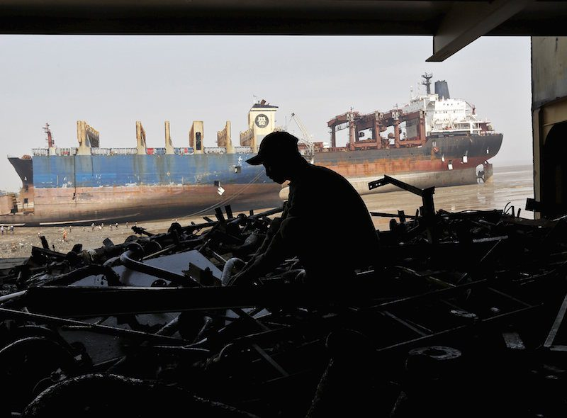 A worker sorts out the engine parts of a decommissioned ship as he dismantles it at the Alang shipyard in Gujarat, India, in this March 27, 2015 file photo. REUTERS/Amit Dave/Files