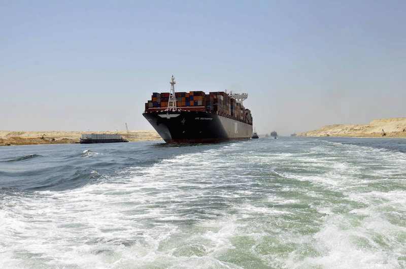 A cargo ship is seen crossing through the New Suez Canal during a test run of the New Suez Canal held July 25, 2015. Photo: REUTERS/Stringer