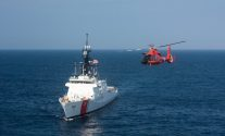 "The Coast Guard's latest 418-foot National Security Cutter, James (WSML 754), is underway in the Atlantic Ocean with an MH-65 ""Dolphin"" helicopter, Thursday, July 30, 2015. The James is the fifth of eight planned National Security Cutters – the largest and most technologically advanced class of cutters in the Coast Guard's fleet. The cutters' design provides better sea-keeping, higher sustained transit speeds, greater endurance and range, and the ability to launch and recover small boats from astern, as well as aviation support facilities and a flight deck for helicopters and unmanned aerial vehicles. (U.S. Coast Guard photo by Auxiliarist David Lau)"