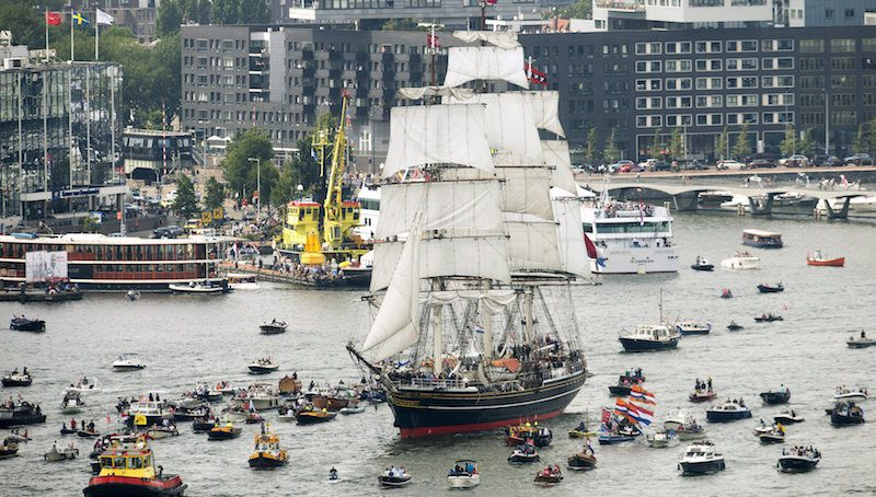 The Stad Amsterdam (C) clipper sails during the Sail-In Parade marking the beginning of the Sail Amsterdam 2015 nautical festival held every five years in Amsterdam, Netherlands August 19, 2015. REUTERS/Toussaint Kluiters/United Photos