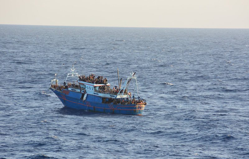 A fishing boat carrying migrants in the Mediterranean is seen from the commercial ship CS Caprice in this handout photograph taken October 22, 2014. Campbell Shipping/Reuters