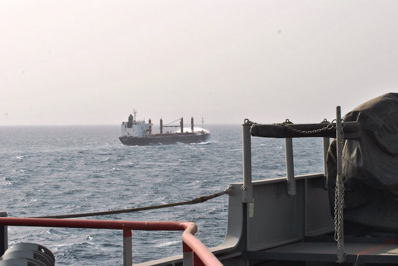 An EUNAVFOR warship escorts a merchant vessel in the Gulf of Aden. Photo: EUNAVFOR