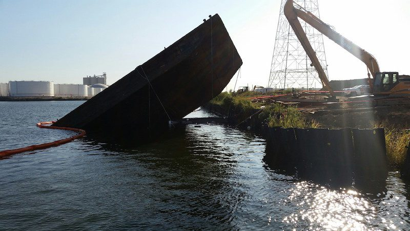 The Coast Guard closed a section of the Upper Houston Ship Channel Monday, Oct. 19, 2015, after the tug Annie Moon and attached barge sank across from the Kinder Morgan terminals in Galena Park. Photo: U.S. Coast Guard