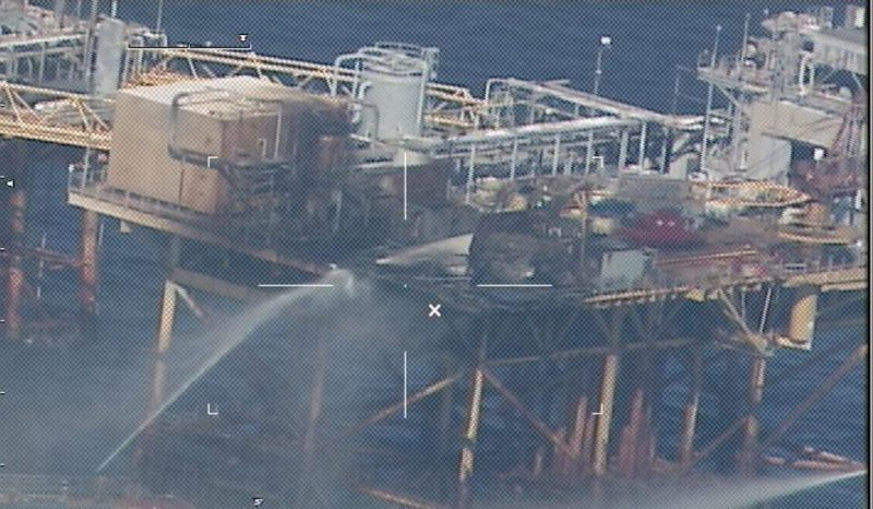 GULF OF MEXICO - Commercial vessels extinguish a platform fire on board West Delta 32 approximately 20 miles offshore Grand Isle, La., in the Gulf of Mexico, Nov. 16, 2012. First responders medevaced nine of the platform's 22 personnel to nearby rigs. U.S. Coast Guard photo.