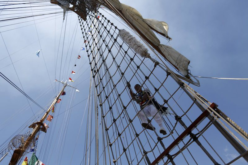 A sailor climbs up the mast of Mexico's naval training ship ARM Cuauhtemoc after its arrival in Puerto Quetzal, Guatemala