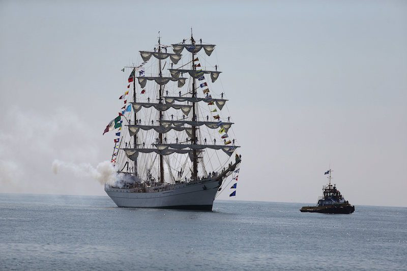 Mexico's naval training ship ARM Cuauhtemoc fires a cannon during its arrival at Puerto Quetzal, Guatemala