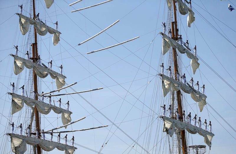 Sailors stand on the mast during the arrival of Mexico's naval training ship ARM Cuauhtemoc in Puerto Quetzal, Guatemala