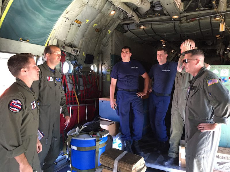 A Coast Guard HC-130 Hercules airplane crew conducts a pre-flight brief prior to launching from Air Station Barbers Point in response to a report of 40 people abandoning ship south of the Hawaiian Islands, Feb. 10, 2016. U.S. Coast Guard Photo