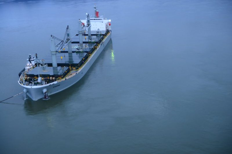 The motor vessel Sparna, a 623-foot Panamanian-flagged bulk carrier reportedly briefly ran aground while transiting the Columbia River near Cathlamet, Wash., March 21, 2016. The vessel is safely anchored, and is maintaining position, with the assistance of two tugs, as an approved salvage and repair plan is developed. (U.S. Coast Guard photo by Petty Officer 1st Class Levi Read)