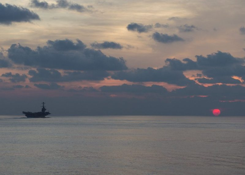 The aircraft carrier USS John C. Stennis (CVN 74) steams at dusk in the South China Sea, April 25, 2016. U.S. Navy Photo