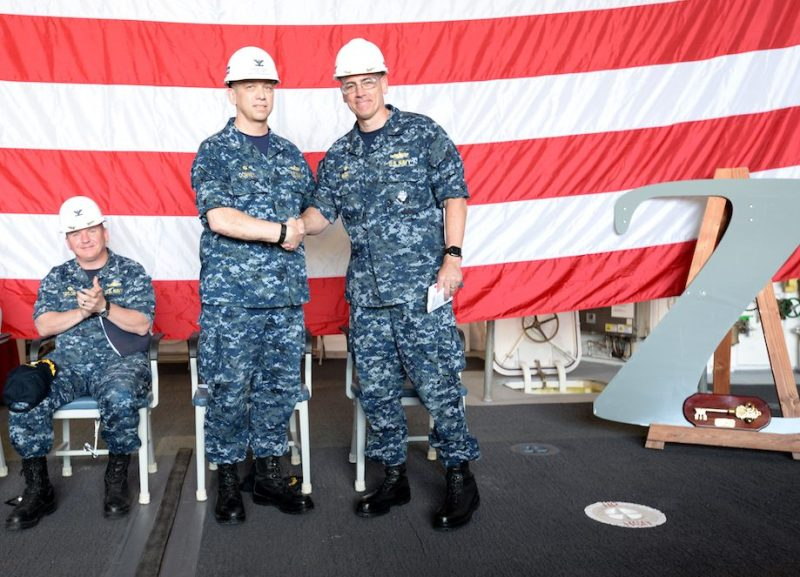 Capt. James A. Kirk, commanding officer of the future guided-missile destroyer USS Zumwalt (DDG 1000), shakes hands with Capt. James Downey, DDG 1000 Program Manager. U.S. Navy Photo