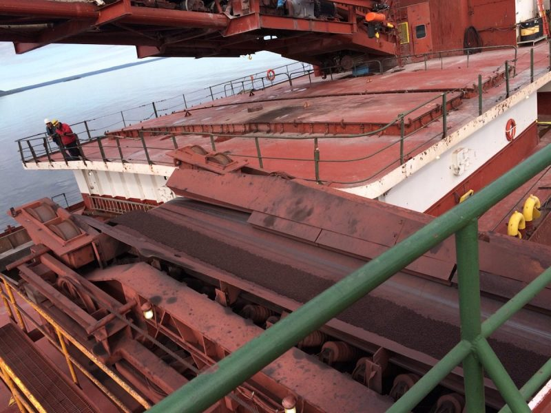 The motor vessel Phillip R. Clarke receives taconite by conveyor belt from the motor vessel Roger Blough that ran aground on May 27, near Gros Cap Reefs Light in Lake Superior, June 3, 2016. The Clarke is scheduled to remove some of the taconite from the Blough in order to lighten the Blough so it can be refloated. (U.S. Coast Guard photo by Craig Gorman)