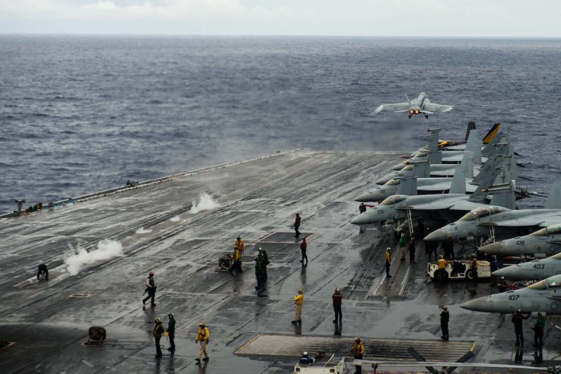 160608-N-MY174-038: PHILIPPINE SEA (June 8, 2016) - An F/A-18E Super Hornet assigned to the Tophatters of Strike Fighter Squadron (VFA) 14 launches off of USS John C. Stennis' (CVN 74) flight deck during routine flight operations.. Providing a ready force supporting security and stability in the Indo-Asia-Pacific, John C. Stennis is operating as part of the Great Green Fleet on a regularly scheduled 7th Fleet deployment. (U.S. Navy photo by Mass Communication Specialist 3rd Class Tomas Compian/ Released)