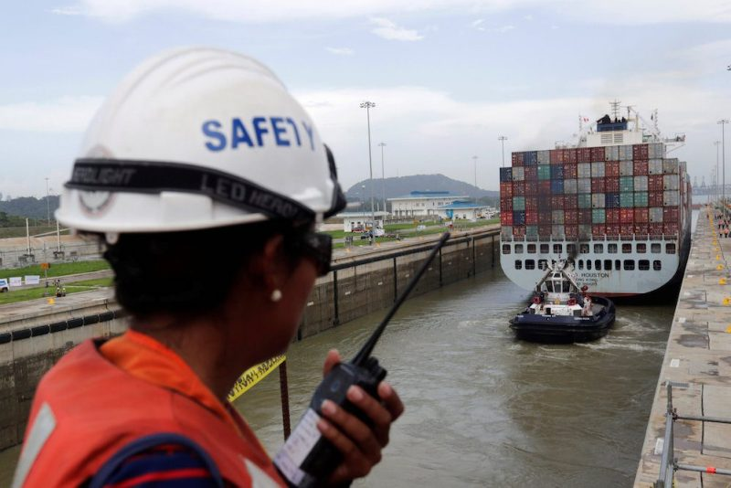 A worker talks on a walkie talkie as cargo ship named Cosco Houston, navigates through Cocoli locks during a test of the new set of locks of the Panama Canal expansion project on the Pacific side in Cocoli, on the outskirts of Panama City, Panama June 23, 2016.  REUTERS/Carlos Jasso
