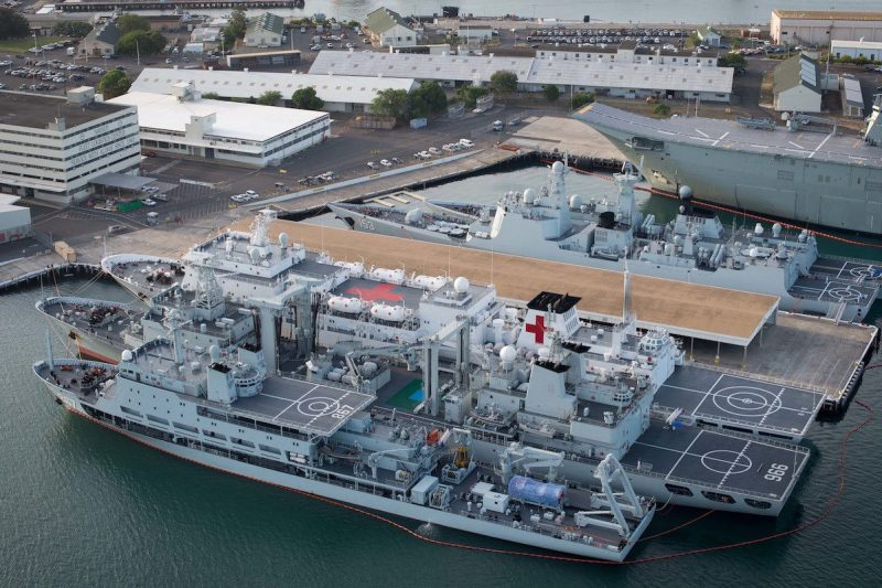 160701-N-SI773-124 JOINT BASE PEARL HARBOR-HICKHAM (July 1, 2016) An aerial view of ships moored at Joint Base Pearl Harbor-Hickam for Rim of the Pacific 2016. Twenty-six nations, more than 40 ships and submarines, more than 200 aircraft, and 25,000 personnel are participating in RIMPAC from June 30 to Aug. 4, in and around the Hawaiian Islands and Southern California. The world's largest international maritime exercise, RIMPAC provides a unique training opportunity that helps participants foster and sustain the cooperative relationships that are critical to ensuring the safety of sea lanes and security on the world's oceans. RIMPAC 2016 is the 25th exercise in the series that began in 1971. (U.S. Navy Combat Camera photo by Mass Communication Specialist First Class Ace Rheaume/Released)