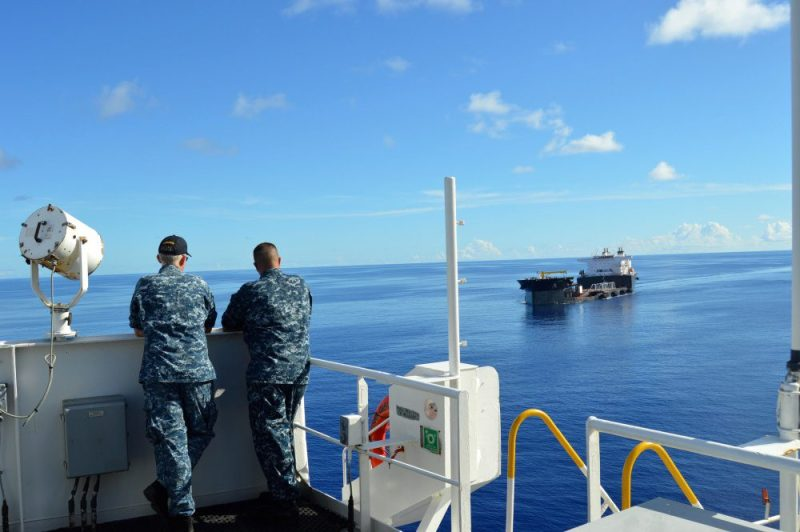 Navy Capt. Stephan Fuller (left), commodore, Military Sealift Command Far East and Navy Capt. Eric C. Lindfors, commodore, Maritime Prepositioning Ships Squadron Three, observe as expeditionary transfer dock USNS Montford Point (T-ESD 1) makes her approach to maritime prepositioning force ship USNS Dahl (T-AKR 312) prior to commencing skin-to-skin operations, July 21. (Courtesy photo)