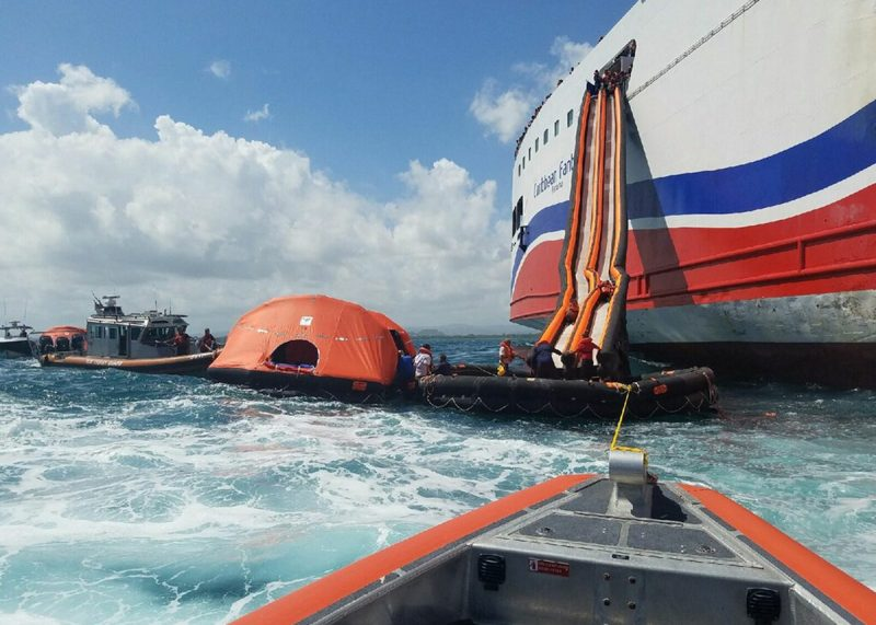 Passengers aboard the 561-foot Caribbean Fantasy ferry vessel use the marine escape system to awaiting lift rafts as they abandon the vessel a mile from San Juan Harbor, San Juan, Puerto Rico, Wednesday, Aug. 17, 2016. The Caribbean Fantasy had a fire start in the engine room that spread to other compartments forcing passengers and crew to abandon the vessel. U.S. Coast Guard photo courtesy of Station San Juan, Puerto Rico.
