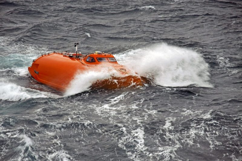 File photo shows a free fall lifeboat as it hits the water during launch. Credit: Norsafe