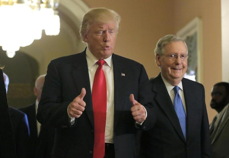 U.S. President-elect Donald Trump gives a thumbs up as he walks with Senate Majority Leader Mitch McConnell (R-KY) on Capitol Hill in Washington, U.S., November 10, 2016. REUTERS/Joshua Roberts