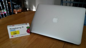 Raspberry Pi Model B+ box with MacBook Air (for scale). (The actual Pi card is quite a bit smaller, yet!)