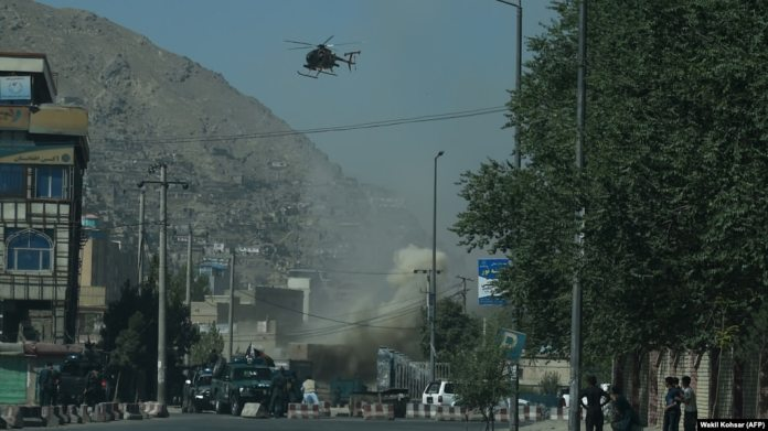 Smoke and dust rise following an air strike from an Afghan military helicopter during clashes between security forces and militants near the Eid Gah Mosque in Kabul last month.