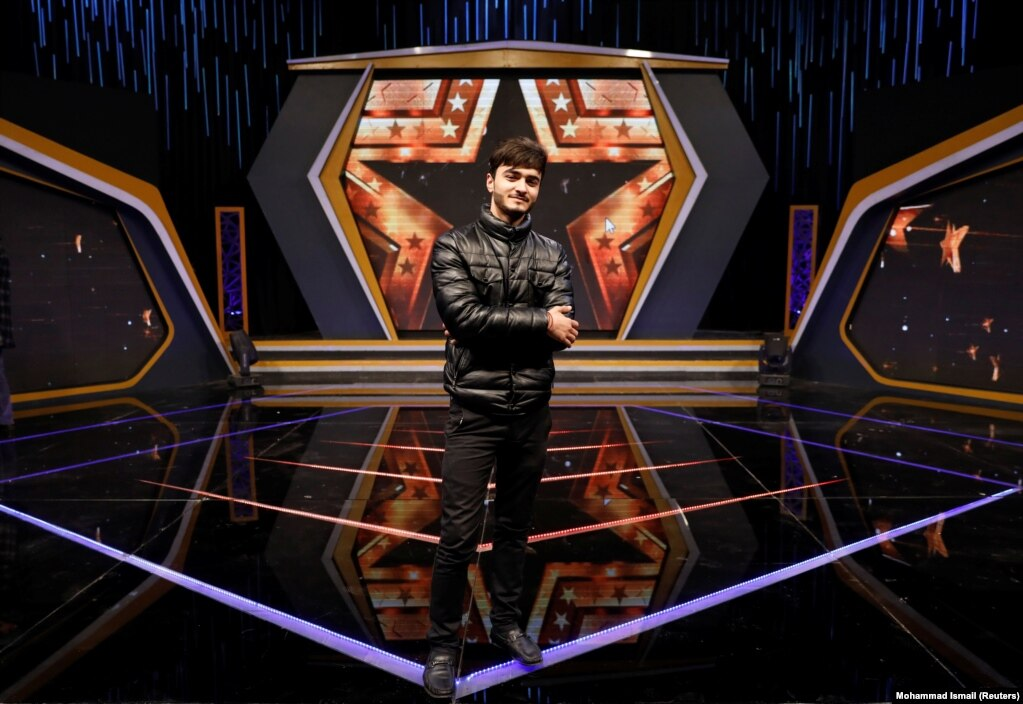 """Singer Wasim Anwari, 19, at the Afghan Star talent show at Tolo television studio in Kabul. """"Without peace there is no hope for a better future."""""""