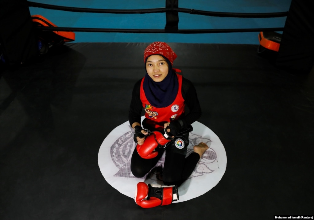 """Kawsar Sherzad, 17, at her Thai boxing club in Kabul. """"Afghan females havemade a lot of achievements in sports. I am optimistic that the Taliban will accept these achievements."""""""