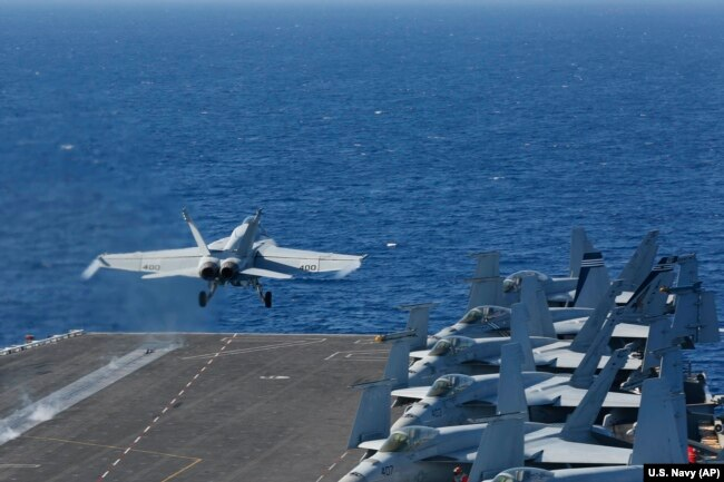 The Pentagon on May 10 said the USS Arlington amphibious assault ship will join the USS Abraham Lincoln Carrier Strike Group (above) and a B-52 bomber task force already headed toward the Persian Gulf. (file photo)
