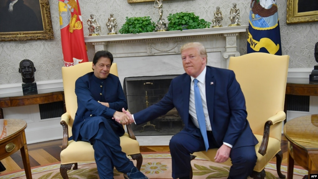 U.S. President Donald Trump (right) shakes hands with Pakistani Prime Minister Imran Khan at the White House on July 22.