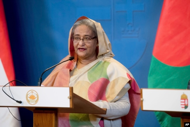 FILE - Bangladeshi Prime Minister Sheikh Hasina speaks at a news conference in Budapest, Hungary, Nov. 29, 2016. Leaders of the opposition Bangladesh Nationalist Party have accused the Hasina-led government of not making public details of an agreement she