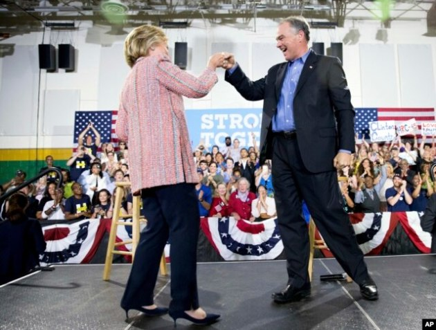 Democratic presidential candidate Hillary Clinton fist bumps Sen. Tim Kaine, D-Va., after speaking at a rally at Northern Virginia Community College in Annandale, Thursday, July 14, 2016.