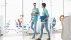 Full-length of businessmen walking at creative work space
