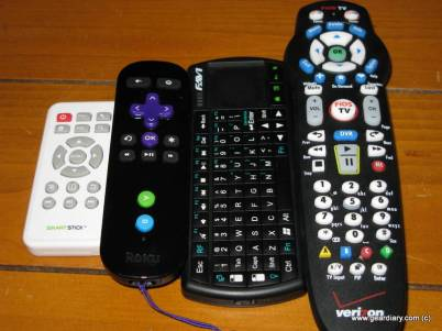 Left to right: SmartStick remote, Roku remote, Mini Keyboard for SmartStick, Verizon FiOS remote