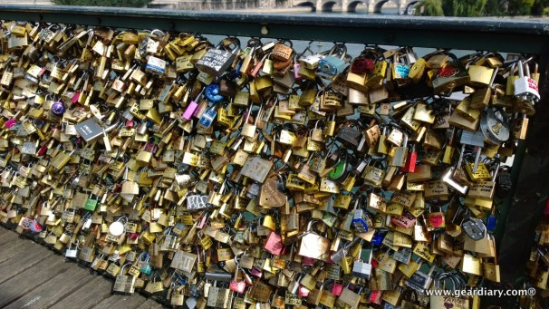 On the Pont de Arts Bridge, lovers attach a lock with their names on them, then they toss the key into the Seine River.