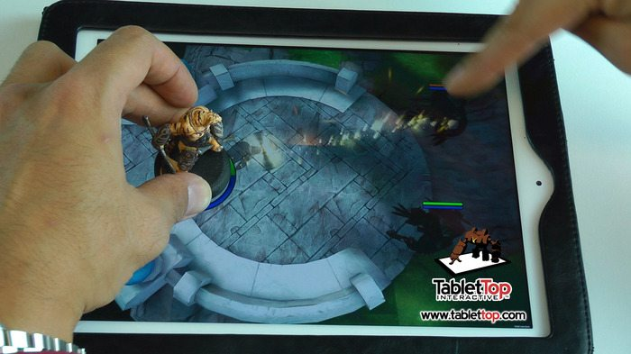 Miniatures played on iPad surface.