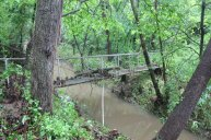 The reason there's a big branch in the bridge, is that the creek was flowing OVER it when the flooding was at it's peak.