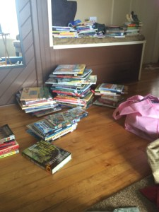 Our neat book piles are no more. Spreading out the books!