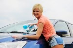 Woman washing car windshield scam