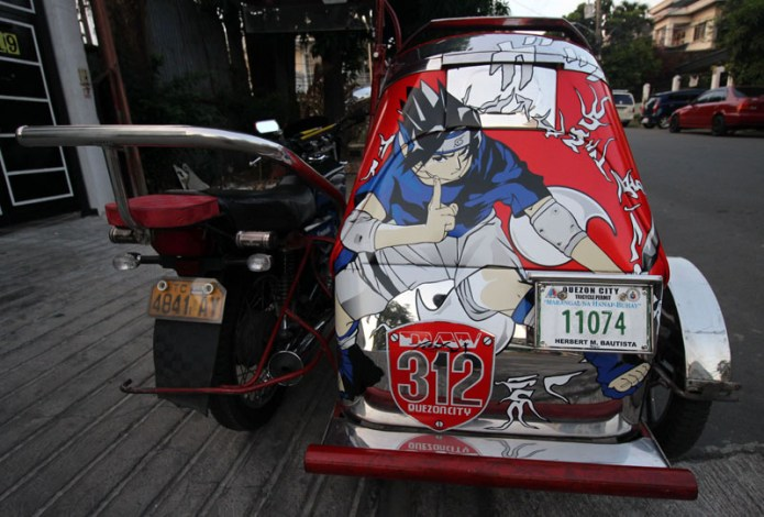 tricycle with an anime character