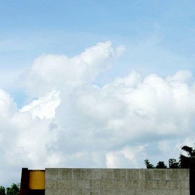 clouds and building rooftop