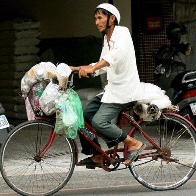 man transporting recyclables on bike