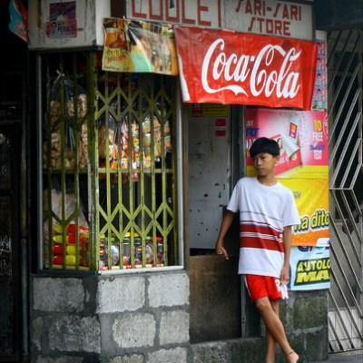 boy standing by a sari-sari store
