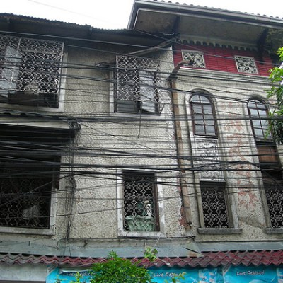 old house with electric wires in front of it